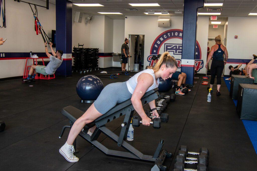 Woman lifting at F45