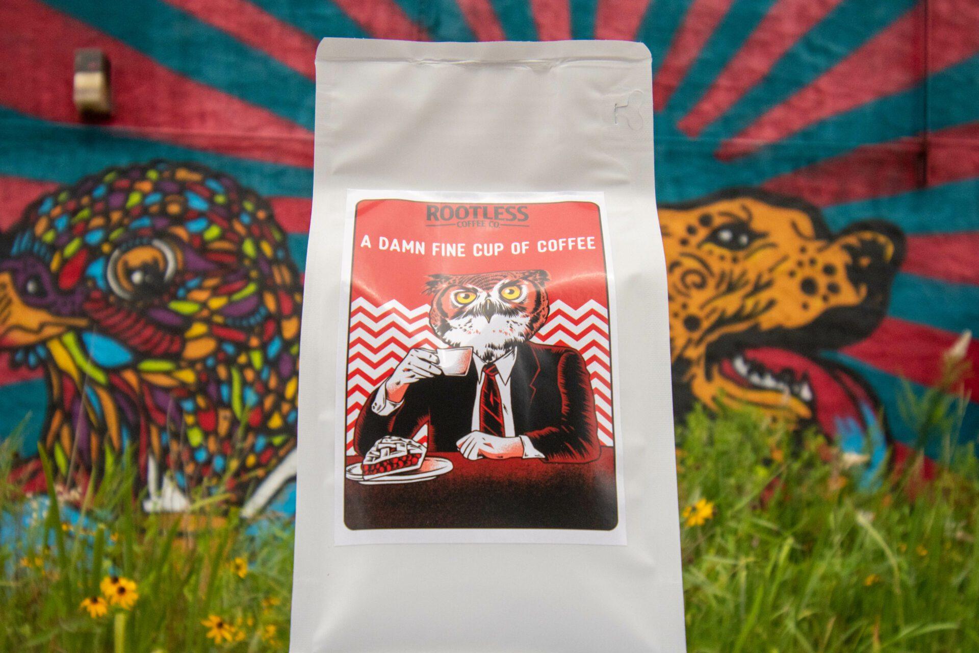 Rootless Coffee in front of Flint Mural